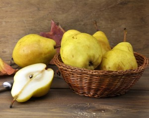 Yellow Pears In A Basket On Wooden Background